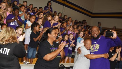 CES students and staff members cheer at the pep rally.