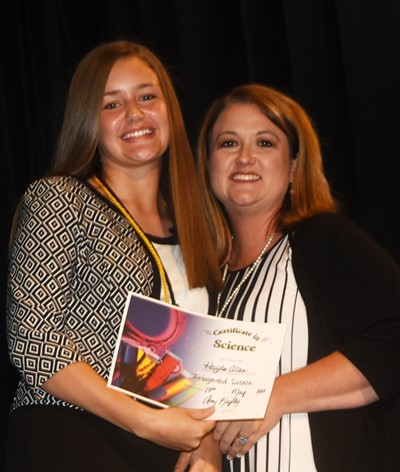 Haylee Allen receives the integrated science award from teacher Amy Knifley.