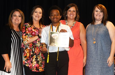 Zamar Owens is honored with the Cameron Smith award. He is pictured with his teachers. From left are Robbilyn Speer, Amy Knifley, Owens, Melisa Morris and Paige Cook.