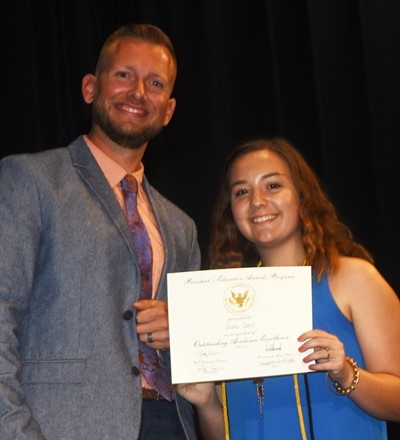 Bri Davis receives the President's Award of Educational Excellence from CMS Principal Zach Lewis.