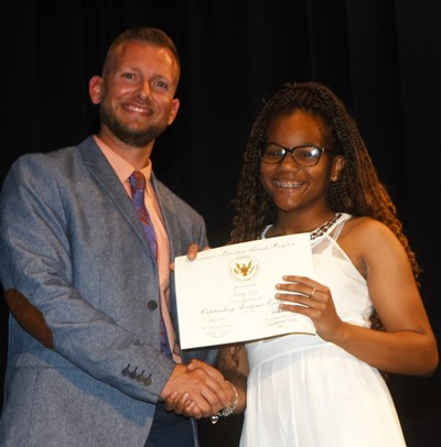 Antaya Epps receives the President's Award of Educational Excellence from CMS Principal Zach Lewis.