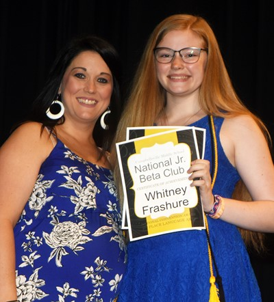 Whitney Frashure is recognized for her Junior Beta Club accomplishments. At left is co-sponsor Natalia Warren.
