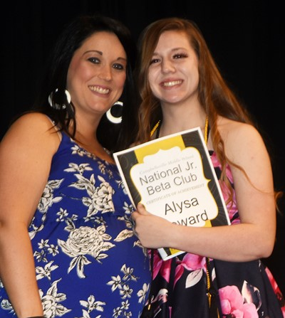 Alysa Howard is recognized for her Junior Beta Club accomplishments. At left is co-sponsor Natalia Warren.