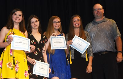 From left, Mikaela Scharbrough, Karlee Rakel, Whitney Frashure and Haylee Allen are recognized for their academic team accomplishments this year. At right is coach Steven Gumm.