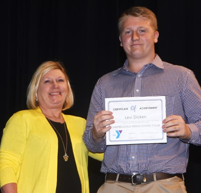 Levi Dicken is recognized for his participation in Y Club this school year. At right is co-sponsor Jan Speer.