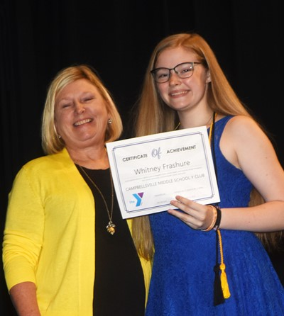 Whitney Frashure is recognized for her participation in Y Club this school year. At right is co-sponsor Jan Speer.