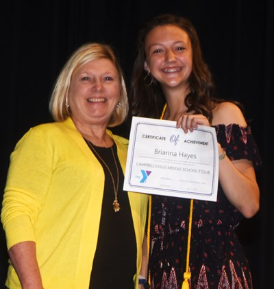 Bri Hayes is recognized for her participation in Y Club this school year. At right is co-sponsor Jan Speer.