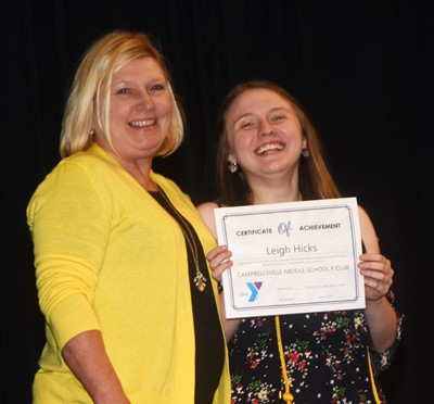 Leigh Hicks is recognized for her participation in Y Club this school year. At right is co-sponsor Jan Speer.
