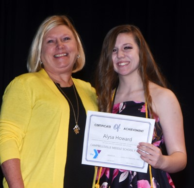 Alysa Howard is recognized for her participation in Y Club this school year. At right is co-sponsor Jan Speer.