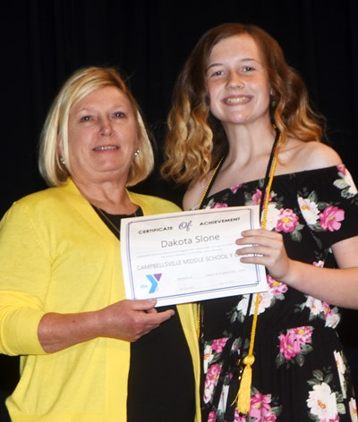 Dakota Slone is recognized for her participation in Y Club this school year. At right is co-sponsor Jan Speer.