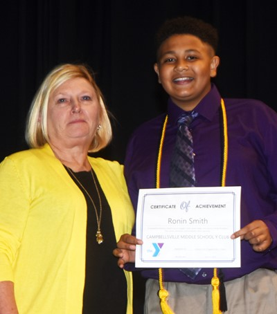 Ronin Smith is recognized for his participation in Y Club this school year. At right is co-sponsor Jan Speer.