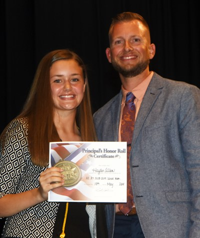 Haylee Allen is honored by being named to the Principal's Honor Roll. At right is CMS Principal Zach Lewis.