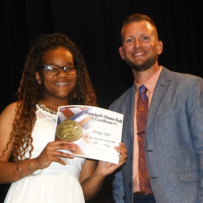 Antaya Epps is honored by being named to the Principal's Honor Roll. At right is CMS Principal Zach Lewis.
