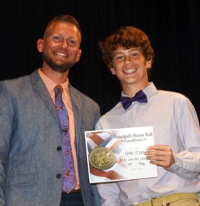 Weston Mattingly is honored by being named to the Principal's Honor Roll. At right is CMS Principal Zach Lewis.