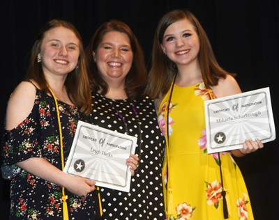 Leigh Hicks, at left, and Mikaela Scharbrough are honored for being chosen to participate in the Rogers Explorers Program this summer. They are pictured with Guidance Counselor Beth Wiedewitsch.