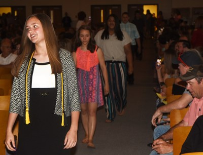 CMS eighth-graders walk in for their recognition ceremony, led by Haylee Allen.