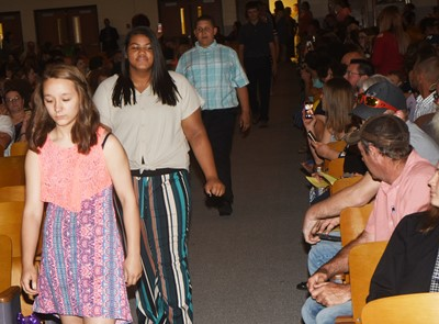 CMS eighth-graders walk in for their recognition ceremony, led by Aquista Anderson.