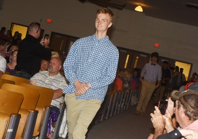 CMS eighth-graders walk in for their recognition ceremony, led by Logan Marples.