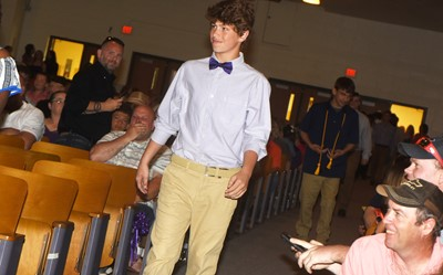 CMS eighth-graders walk in for their recognition ceremony, led by Weston Mattingly.