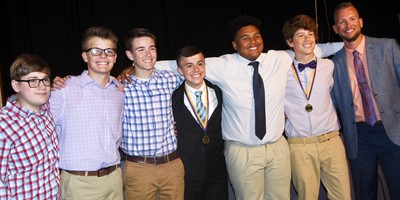 From left, CMS eighth-graders Brady Hoosier, Konner Forbis, Bryce Newton, Chase Hord, J.T. Washington and Weston Mattingly smile for a photo with Principal Zach Lewis.