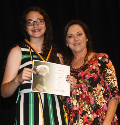 Mary Russell receives the cooperation award from teacher Melisa Morris.