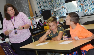 CMS Guidance Counselor Beth Wiedewitsch talks to sixth-graders Easton Williams, at left, and Keaton Hord about the dangers of bullying.