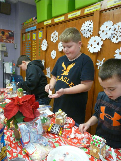 4th Grade builds Gingerbread Houses