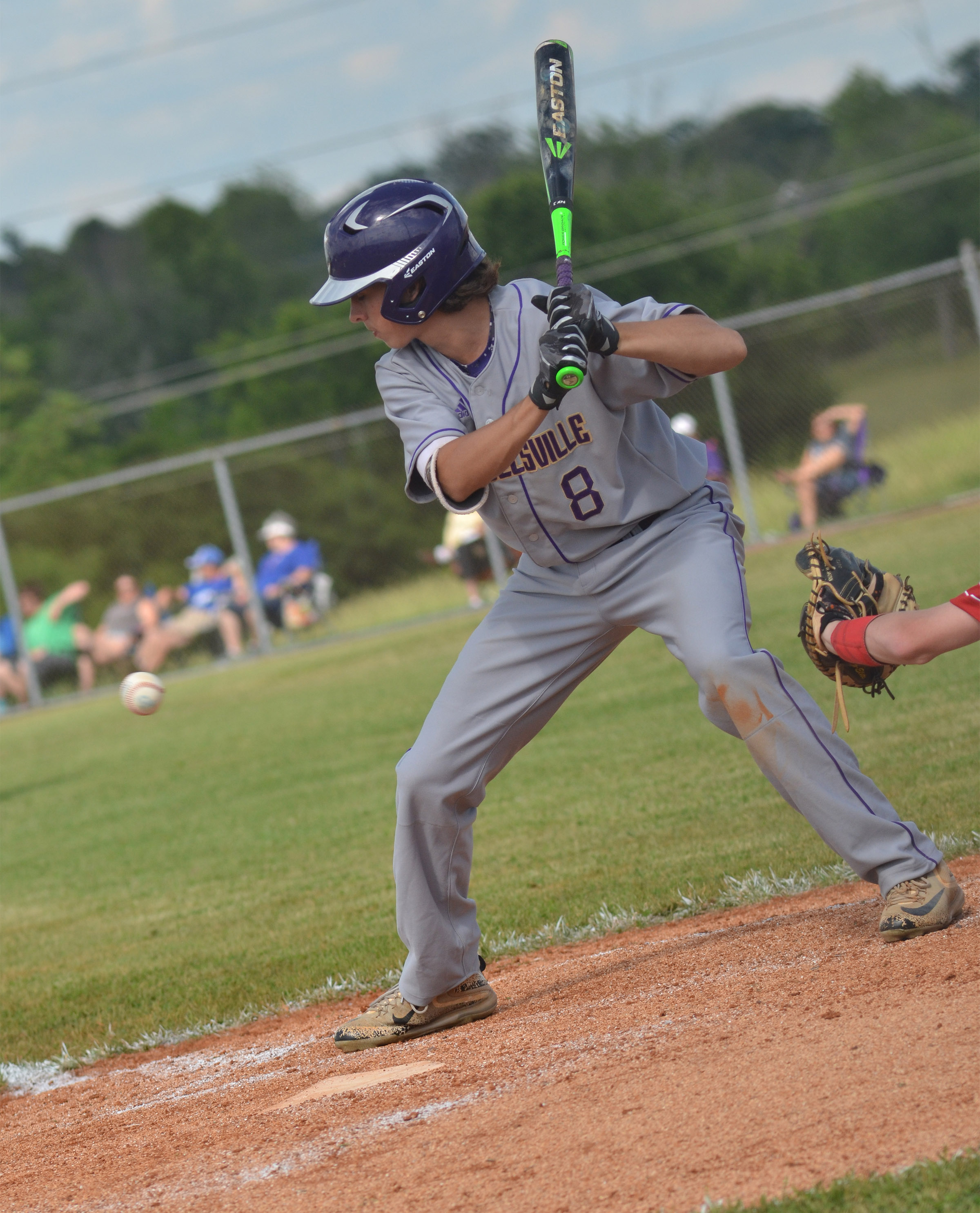 Campbellsville Middle School eighth-grader John Orberson passes on a pitch.