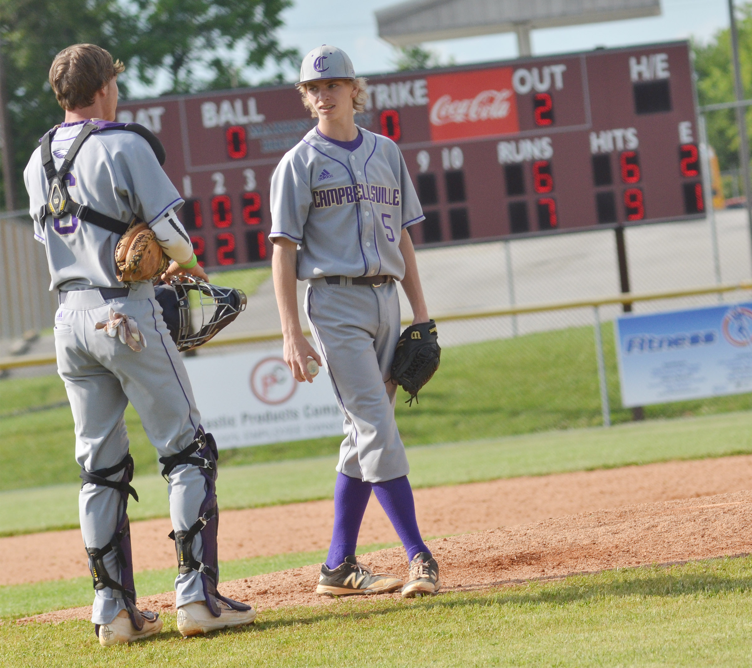 CHS senior Zack Bottoms talks to Campbellsville Middle School eighth-grader Arren Hash during an inning.