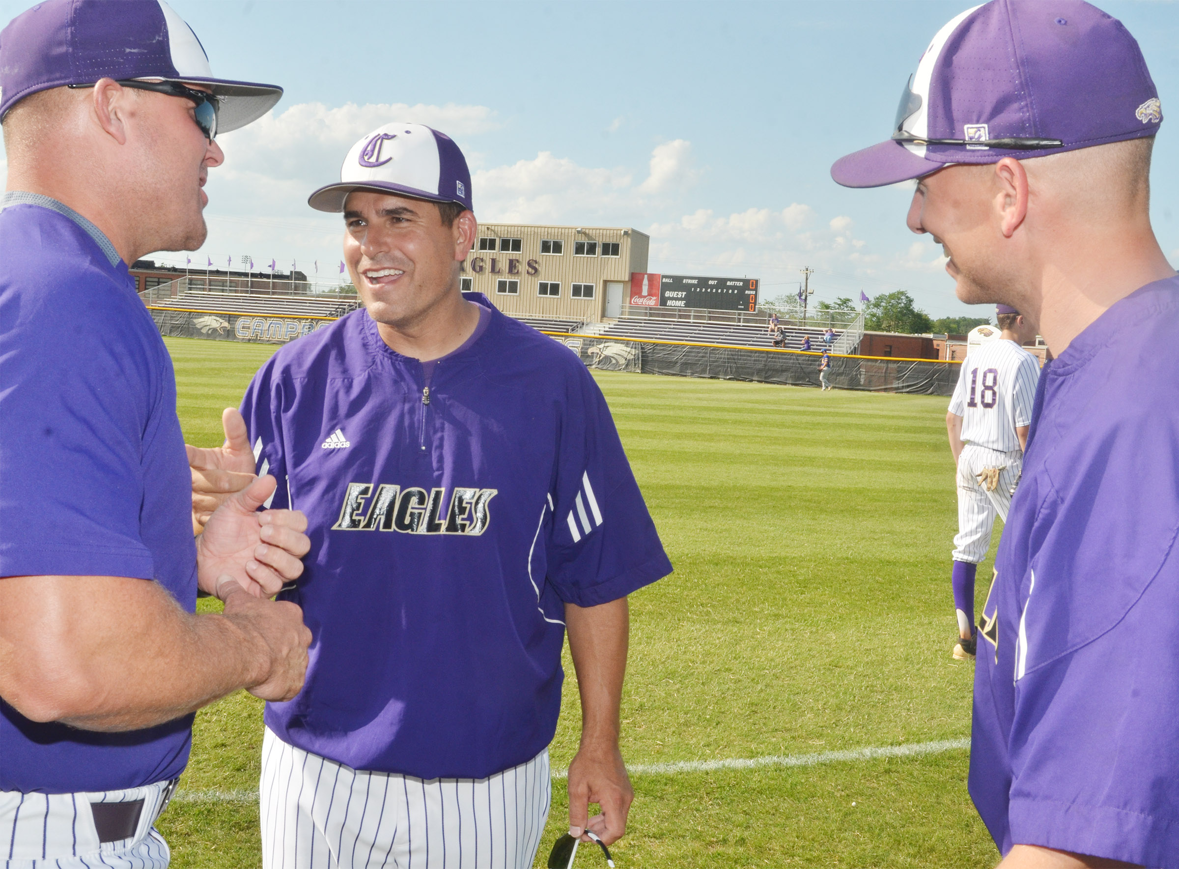 CHS head baseball coach Kirby Smith talks with assistant coaches Daniel Forbis, at left, and Zach Lewis.