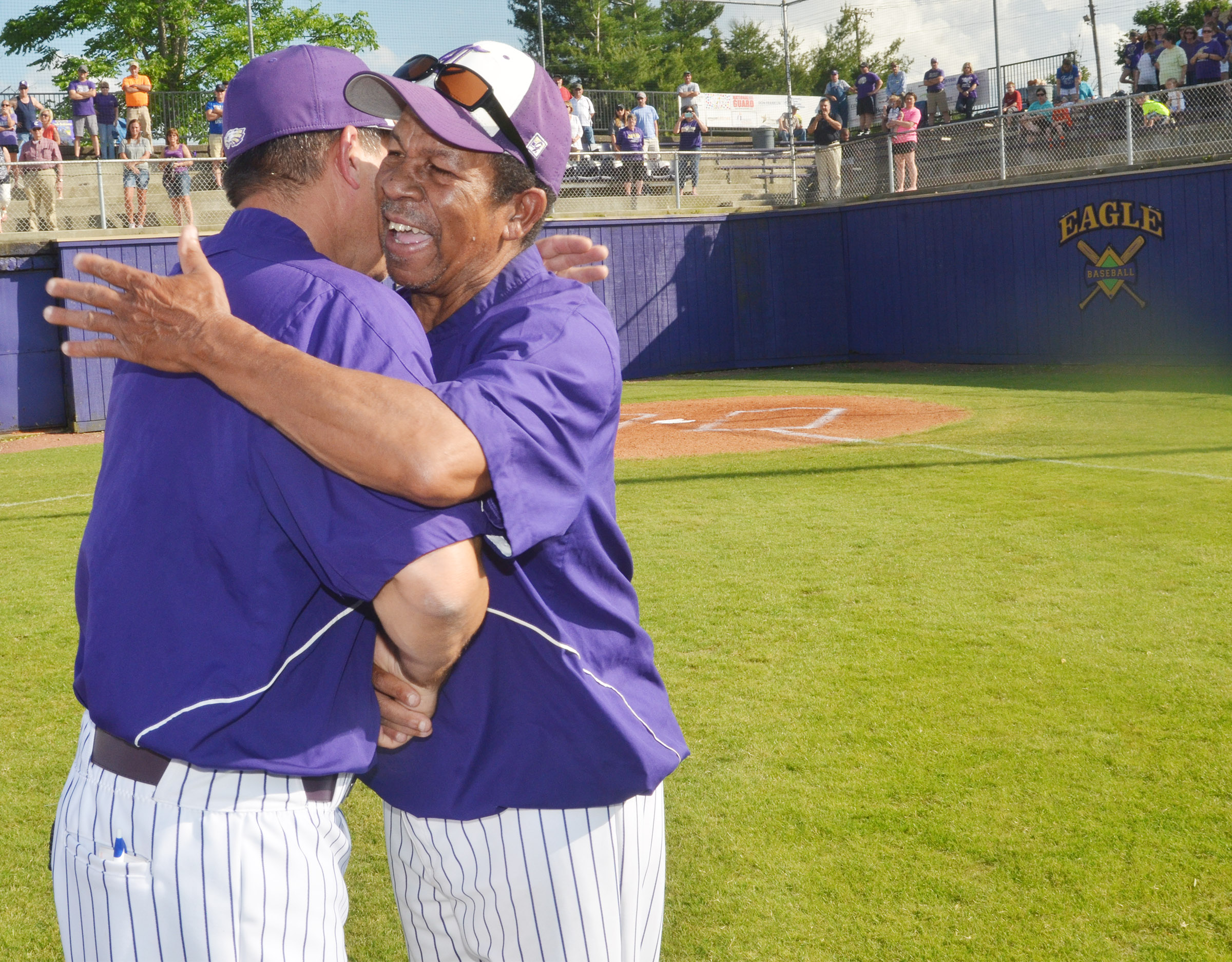 CHS head baseball coach Kirby Smith hugs assistant coach Phil Gowdy. They two have coached together for many years.