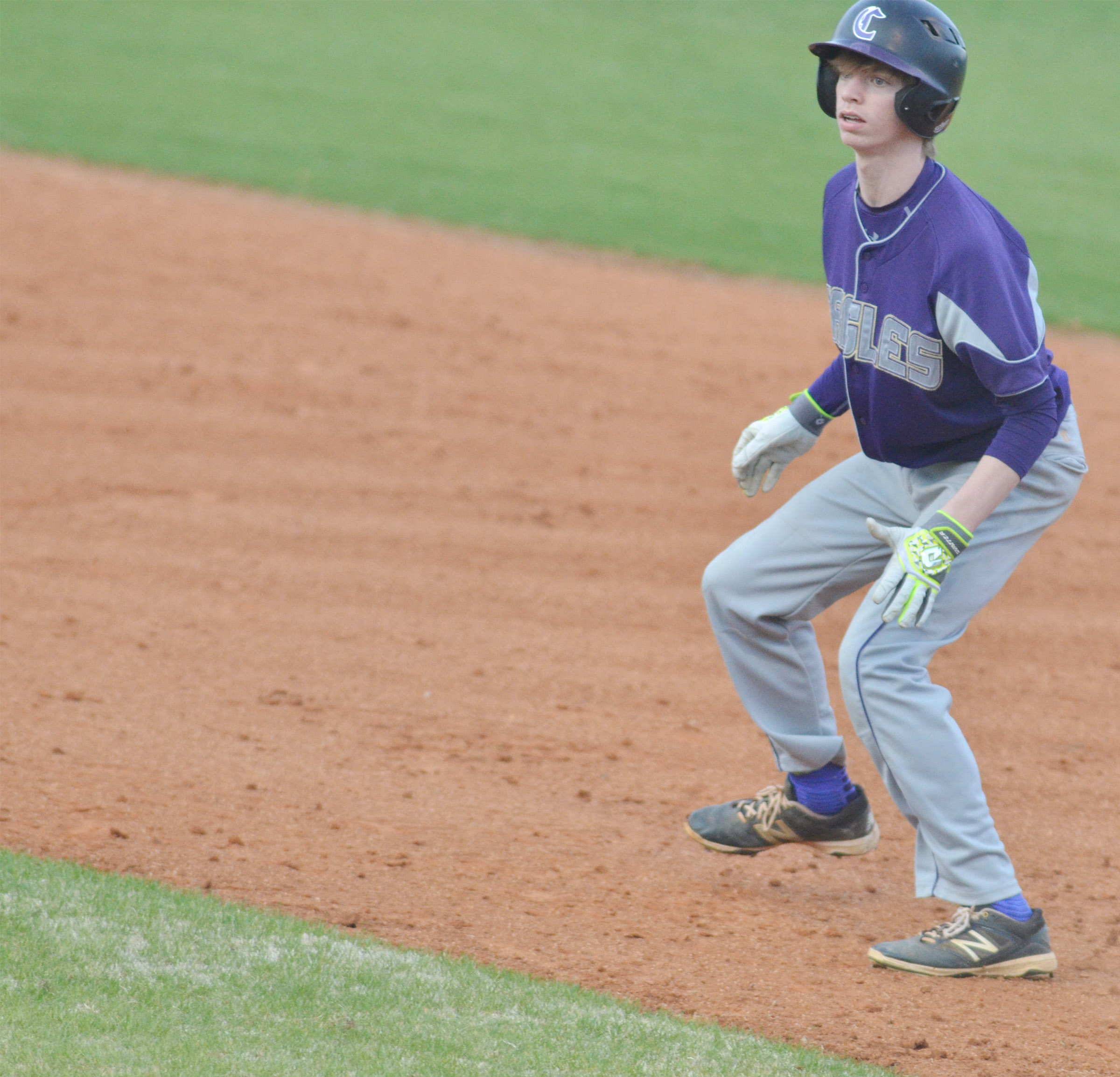 Campbellsville Middle School eighth-grader Arren Hash looks to steal second.