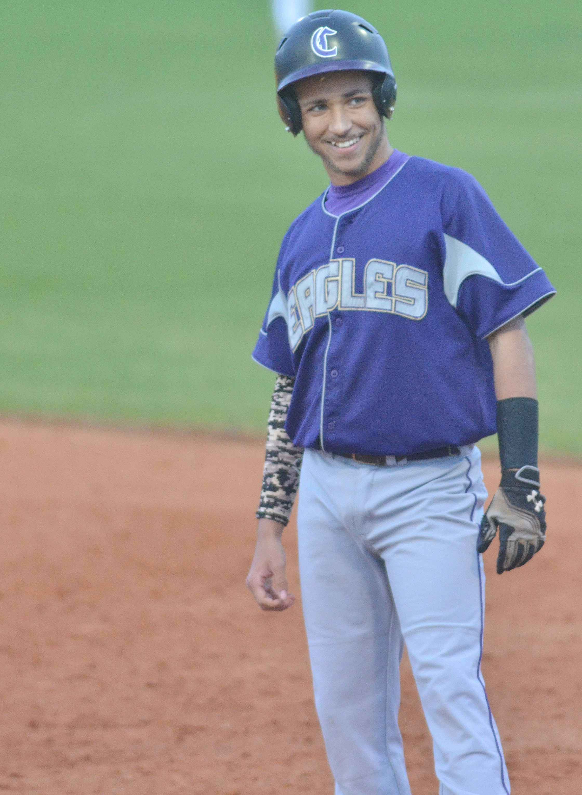 CHS junior Ethan Lay smiles as he makes it to first.