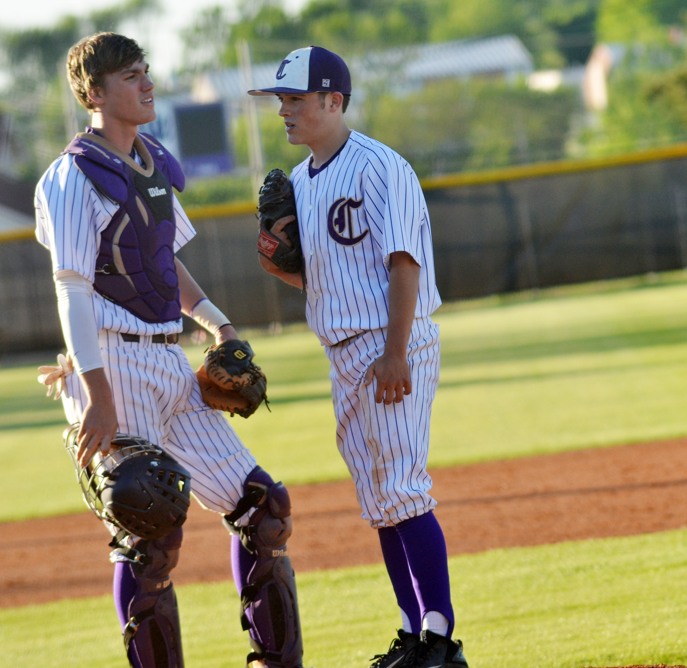 CHS senior Zack Bottoms talks with sophomore Ryan Kearney during an inning.