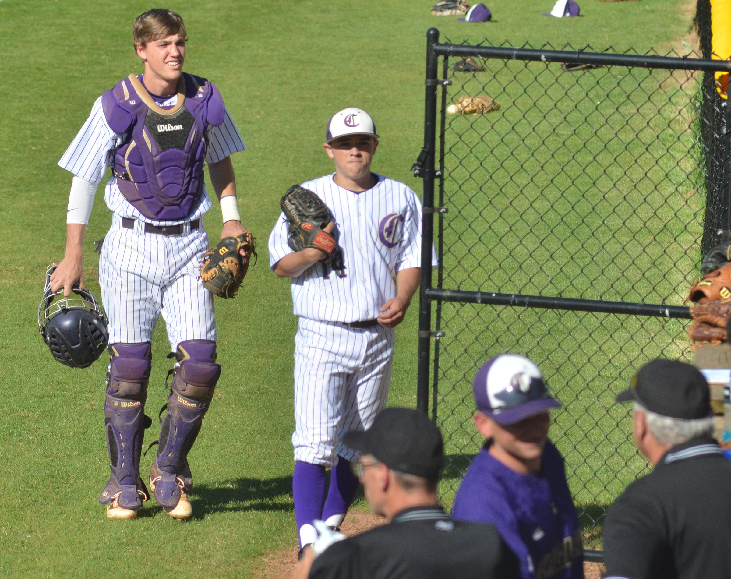 CHS senior Zack Bottoms, at left, and sophomore Ryan Kearney walk to the dugout after warming up for the game.
