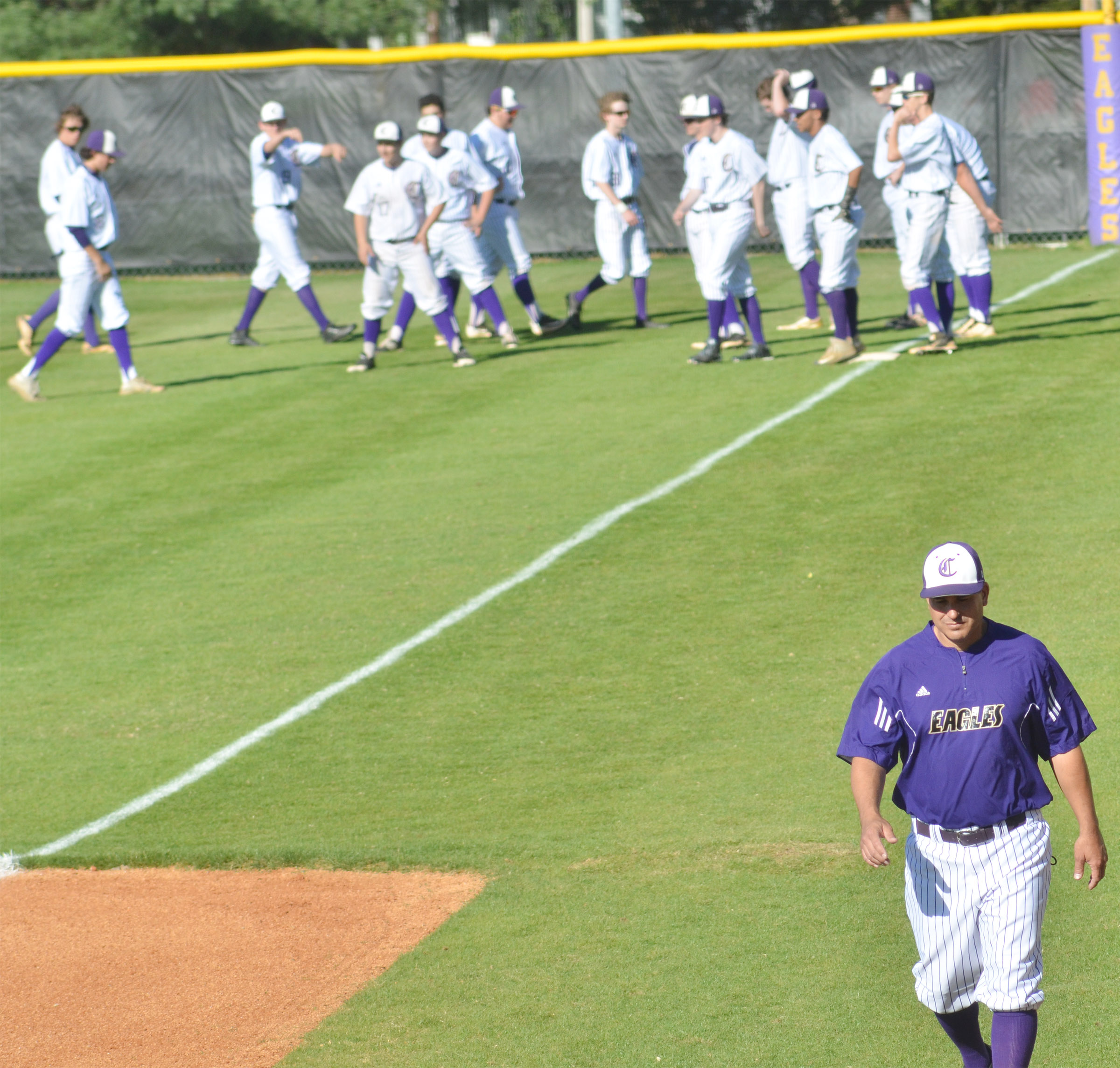 CHS head baseball coach Kirby Smith walks to the dugout after talking to his players.