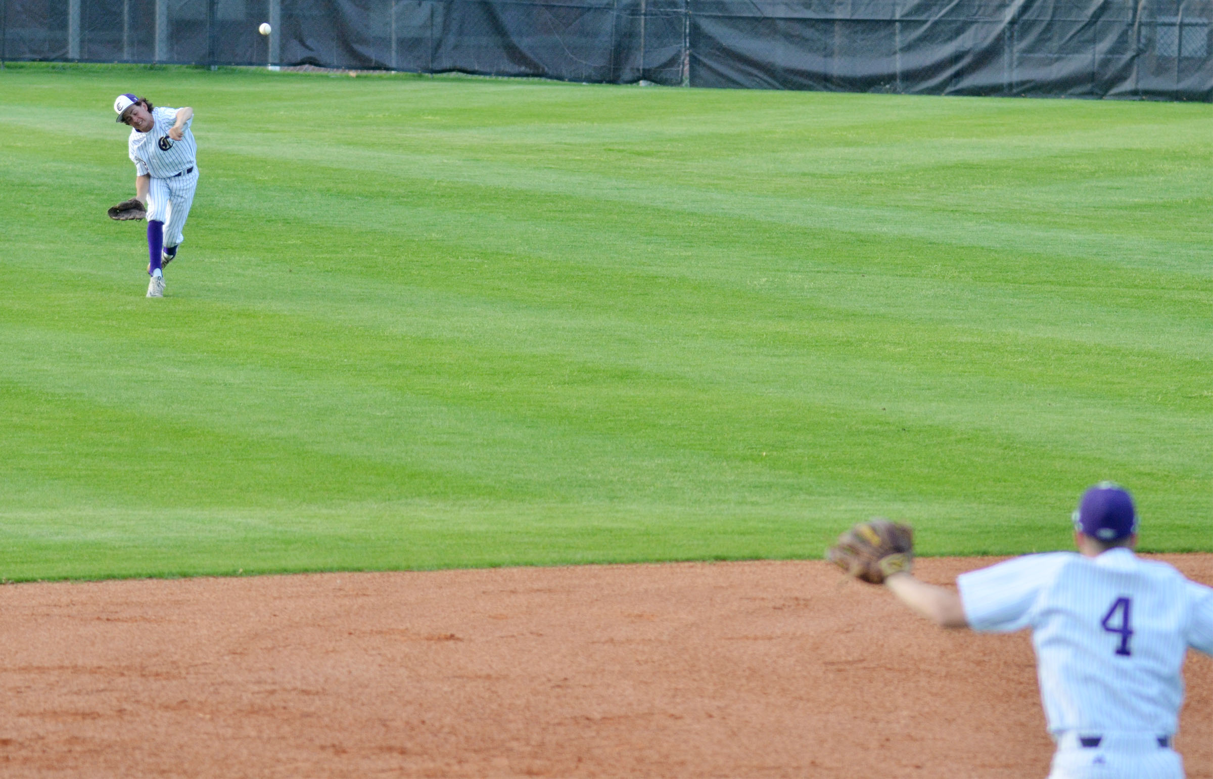 Campbellsville Middle School eighth-grader John Orberson throws the ball to the infield.