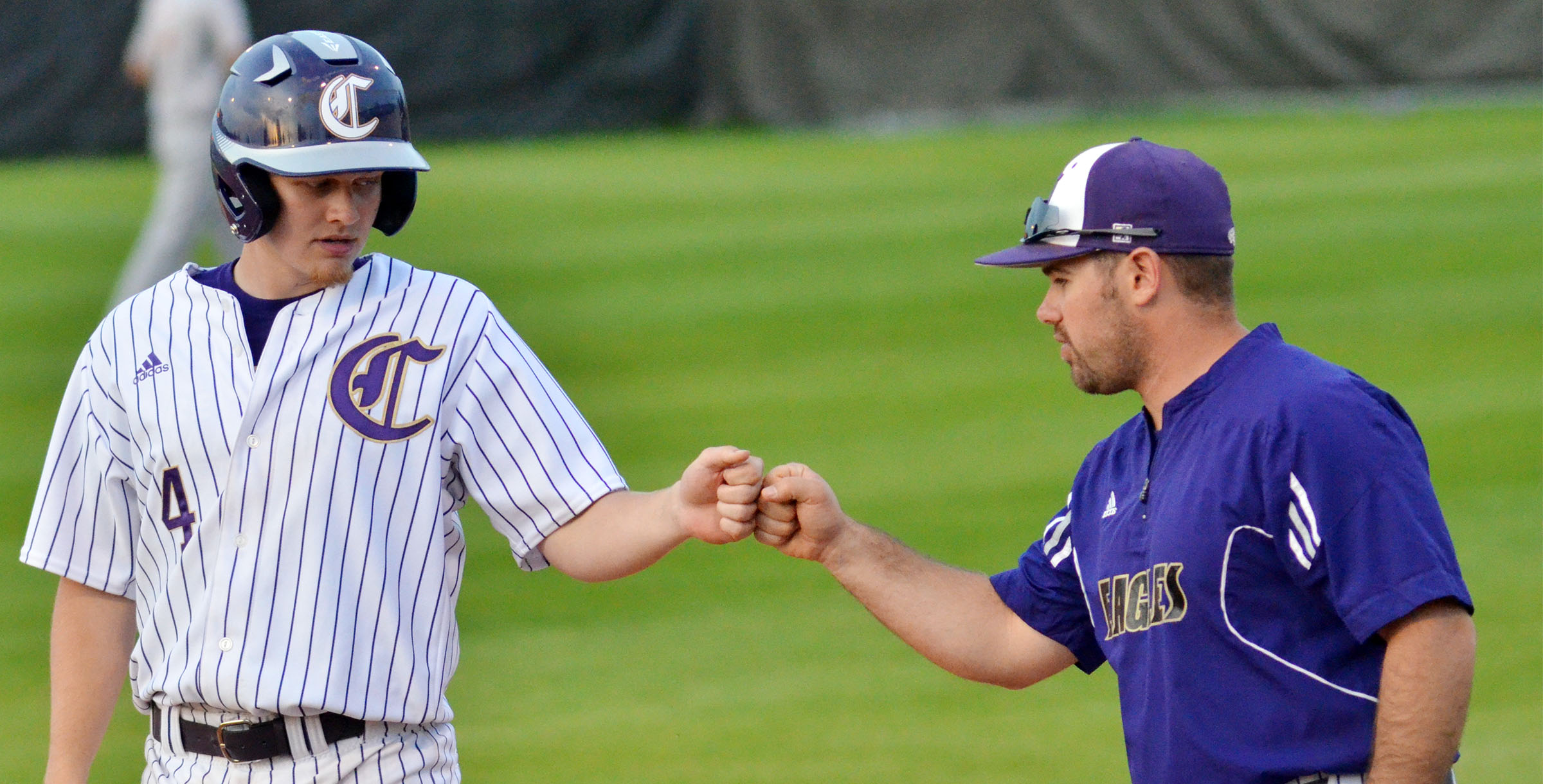 CHS junior Wyatt Houk bumps fists with assistant coach Blake Milby after a hit.