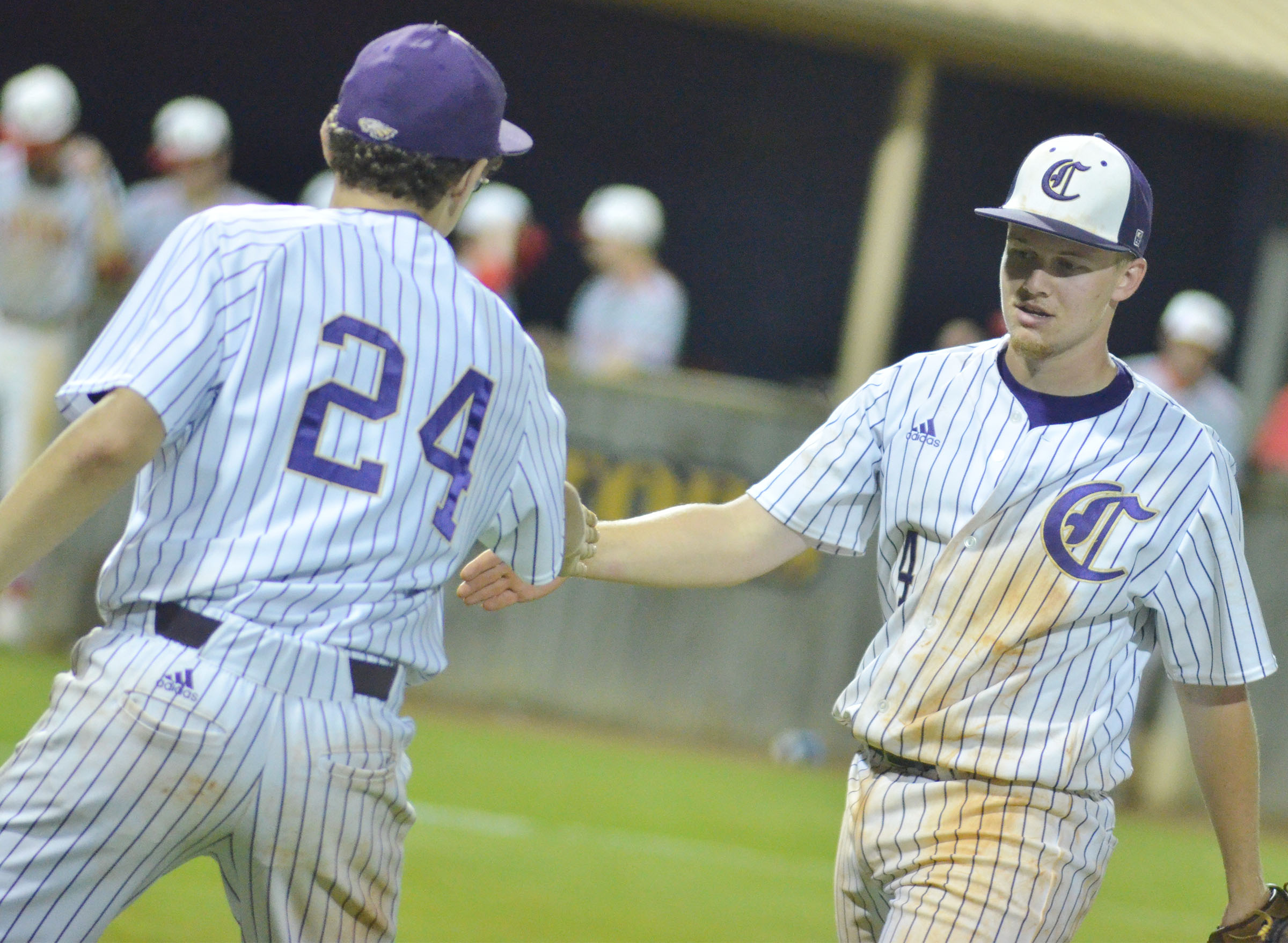 CHS junior Wyatt Houk is congratulated by freshman Brennon Wheeler after getting the save.