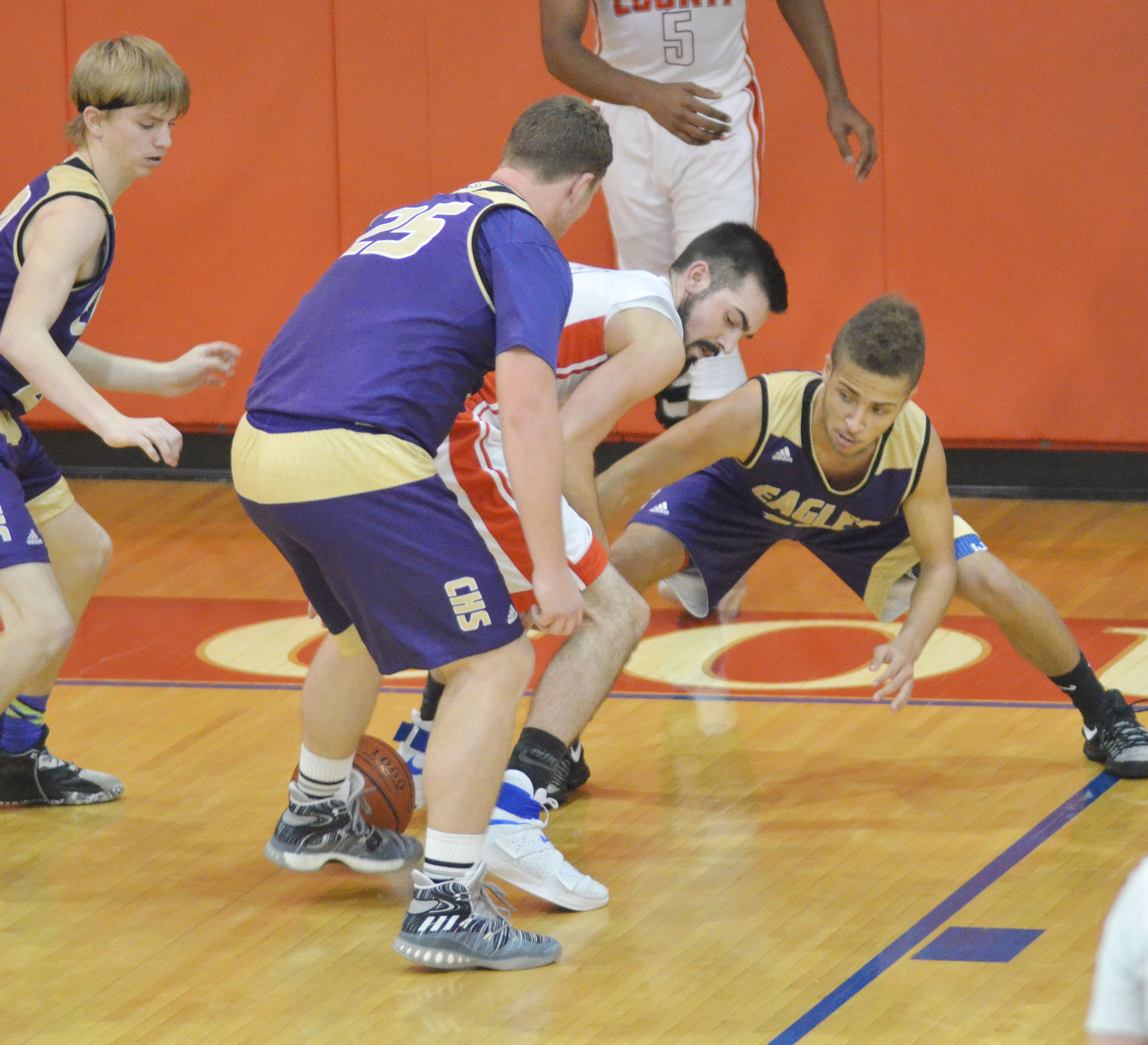 CHS sophomore Lane Bottoms, at left, and junior Ethan Lay fight for the ball.