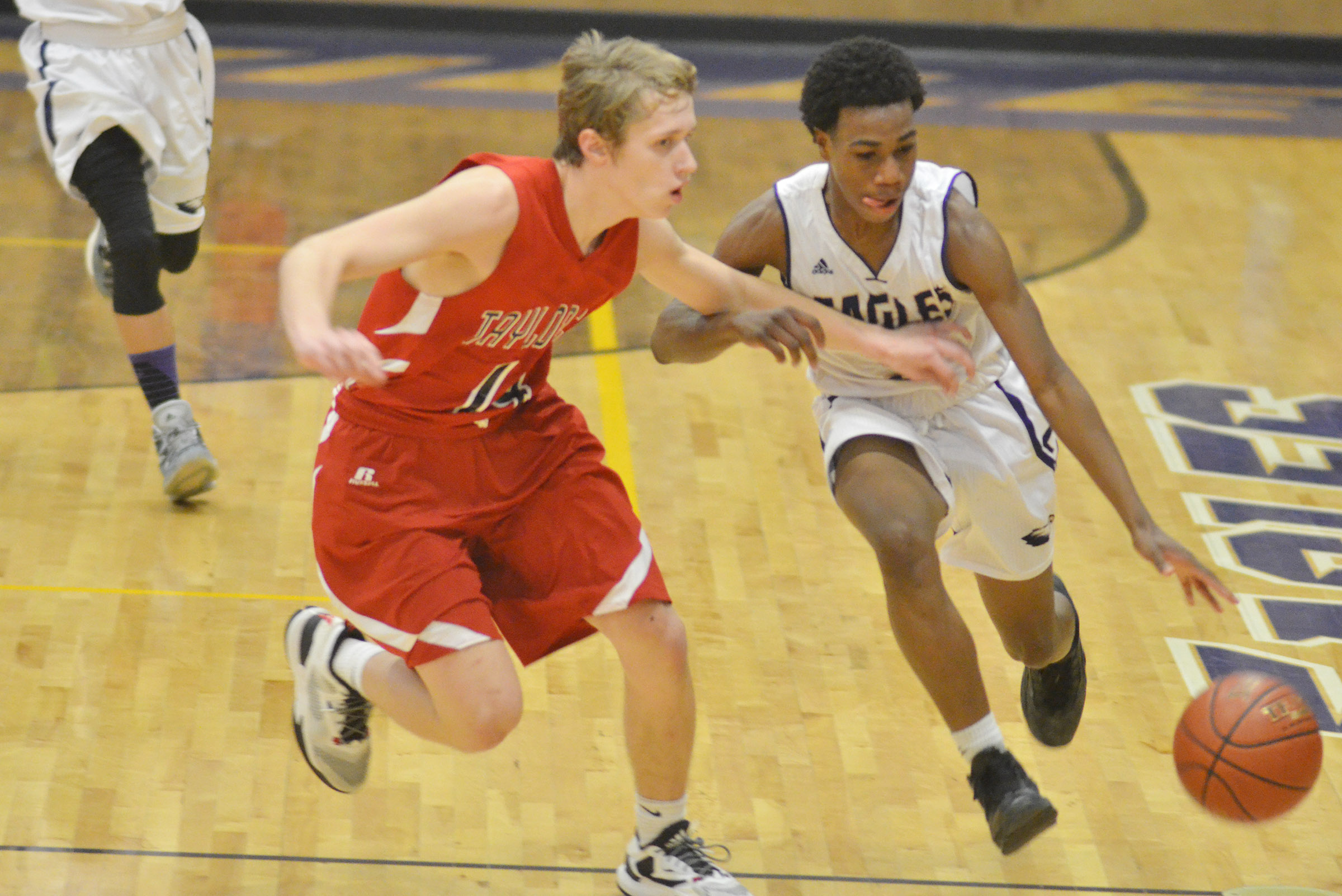 CHS freshman Malachi Corley dribbles to the basket.