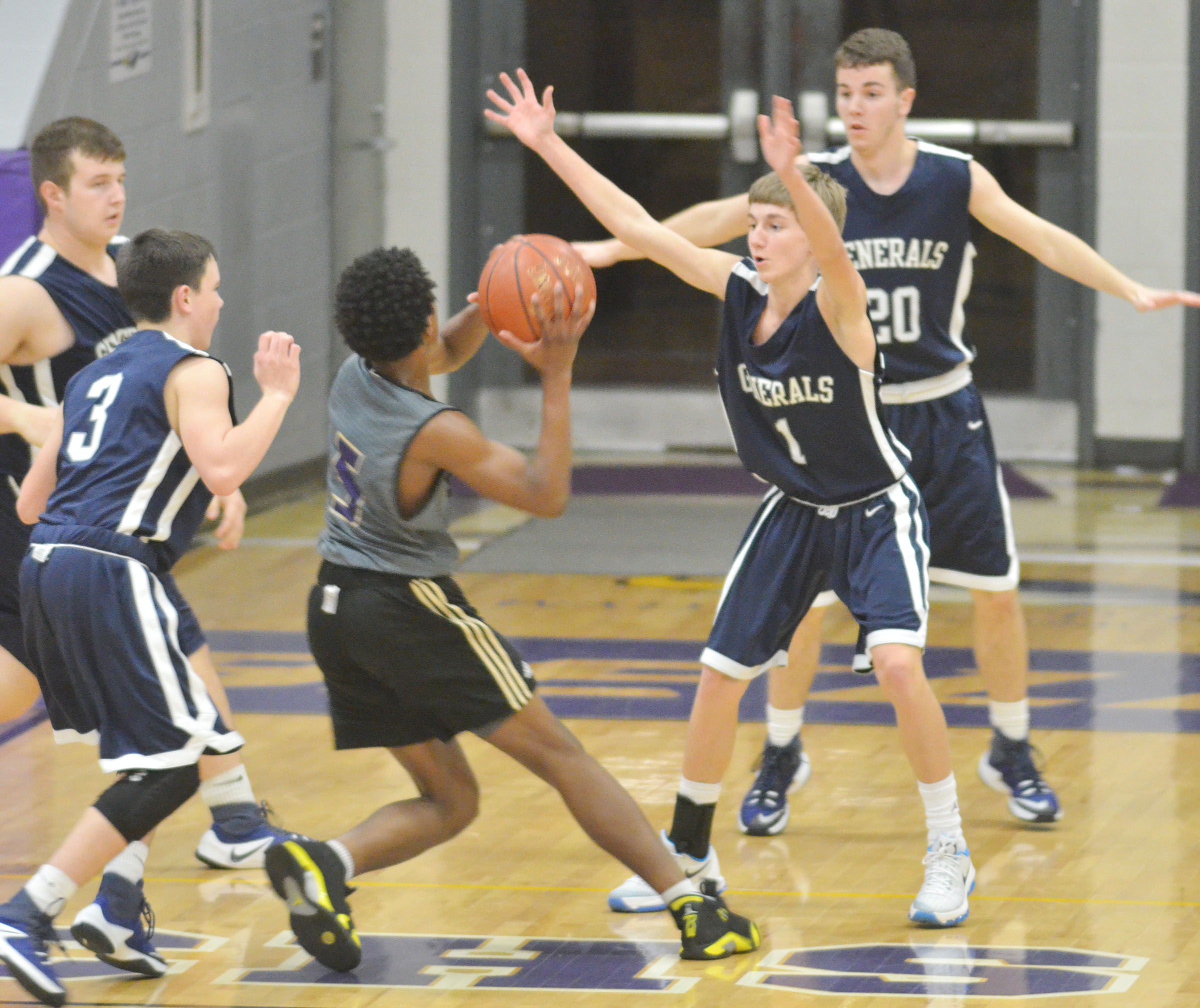 CHS freshman Malachi Corley drives the ball for two points.