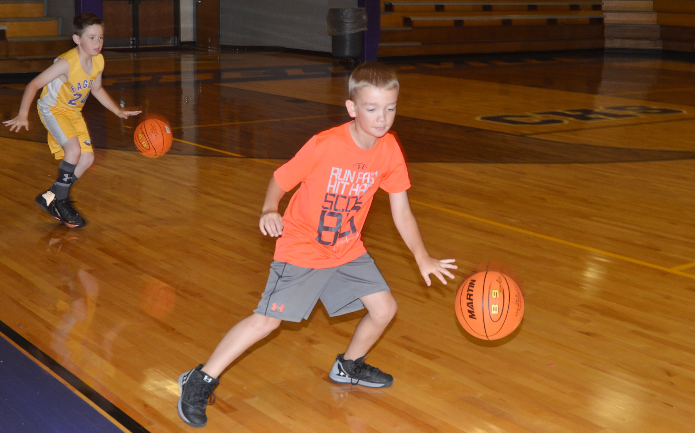 Lanigan Price, at left, and Cameron Estes practice dribbling.