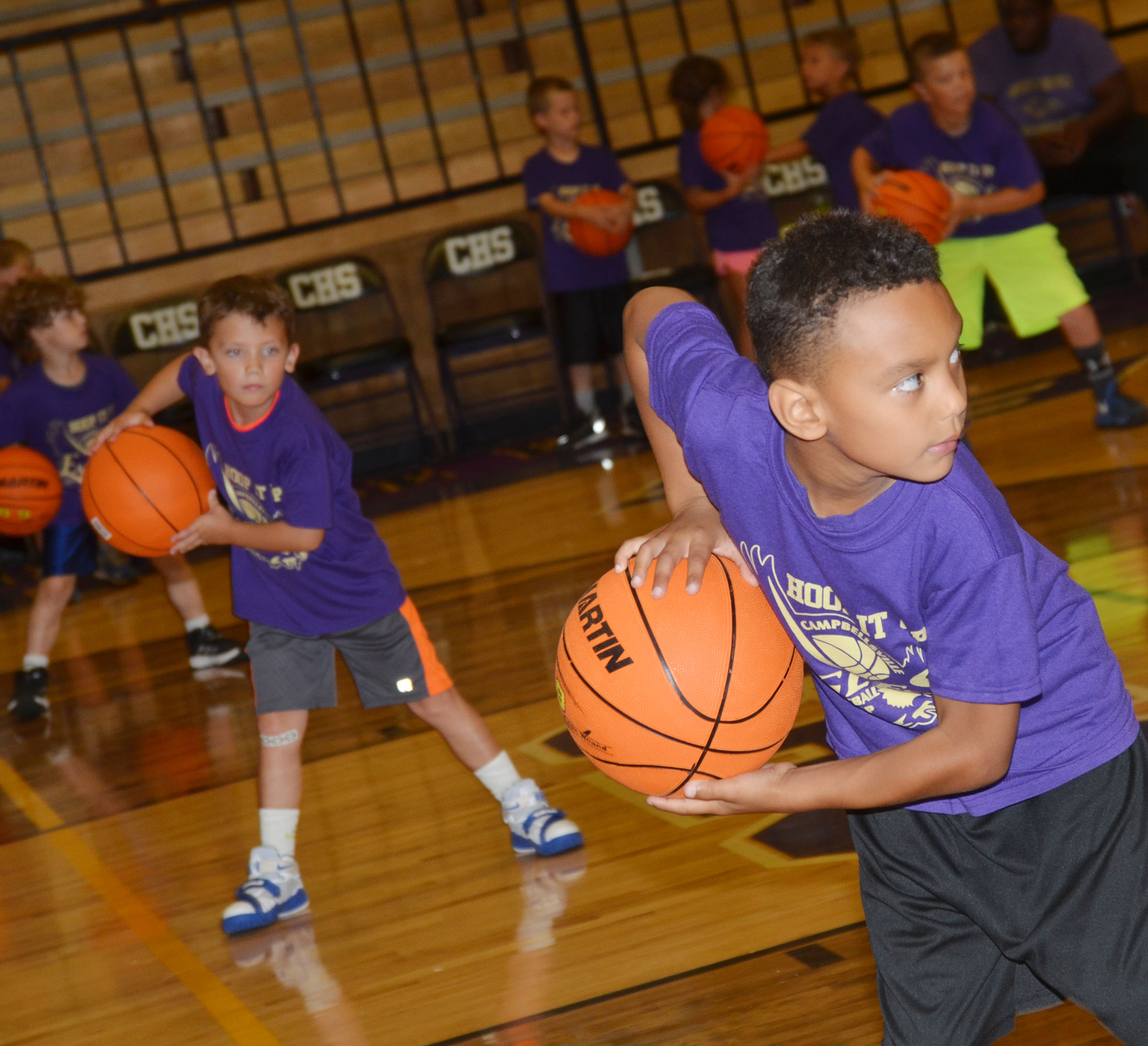 Owen Skaggs, at left, and Maddox Hawkins practice handling the ball.