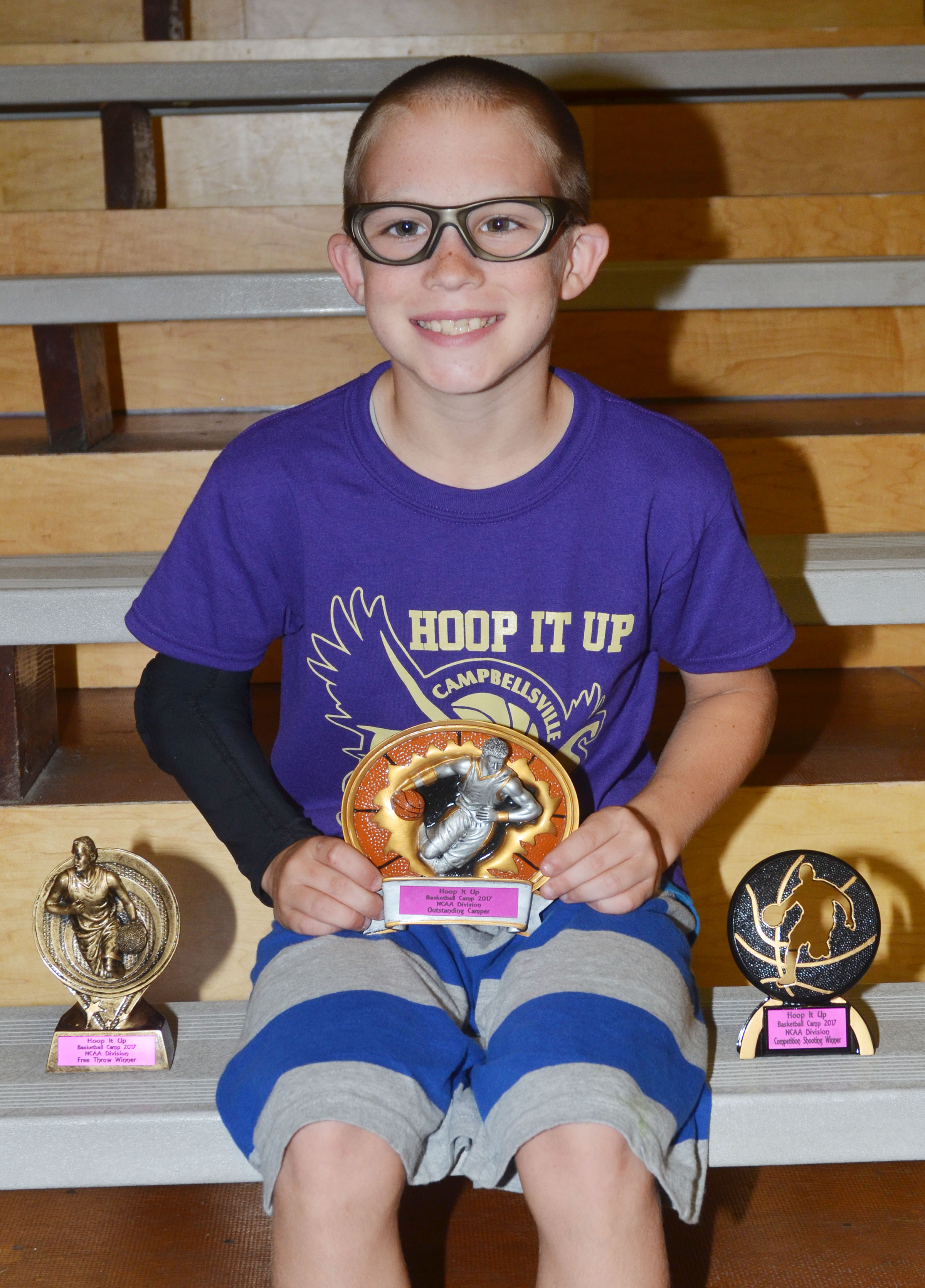 Lee Colvin won camp awards in the NCAA division for free throws, competition shooting and outstanding camper.