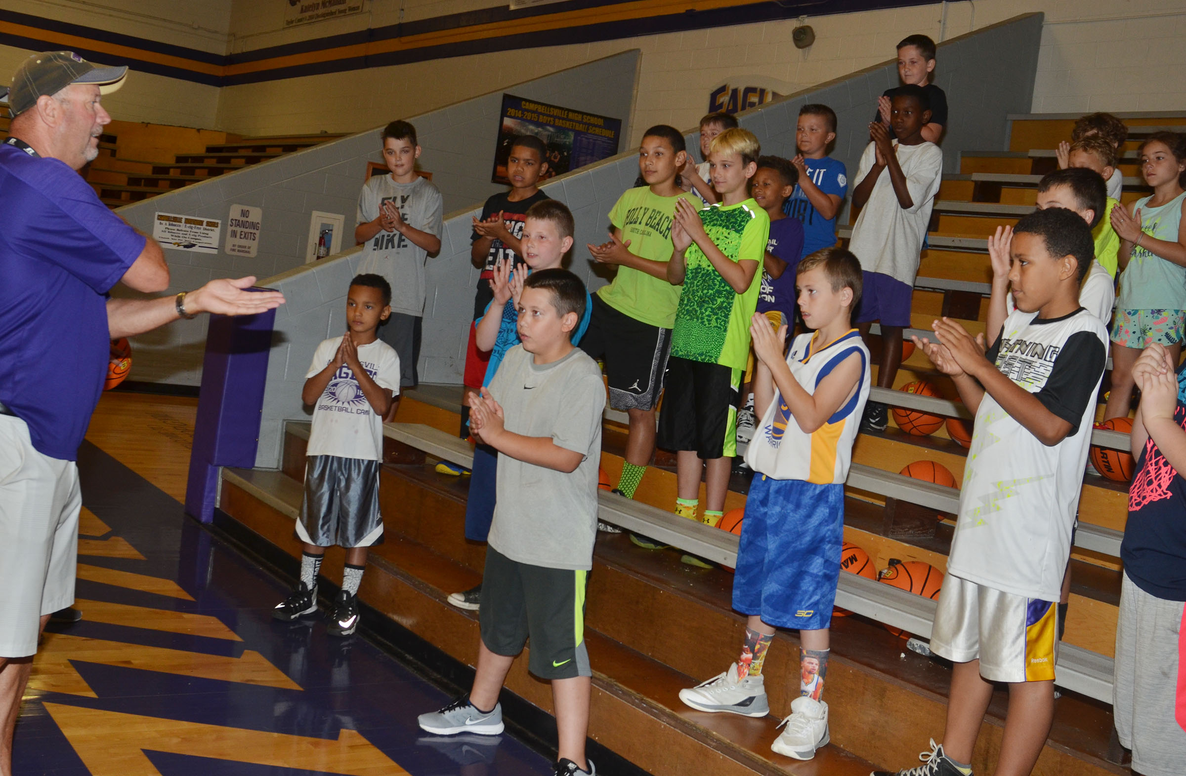 CHS boys' head basketball coach Tim Davis plays a hand-eye coordination game with the campers.