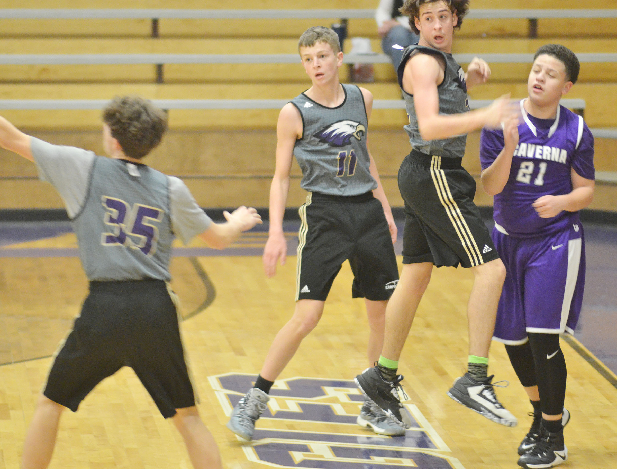 CHS freshman Noah Hughes, center, and Campbellsville Middle School eighth-grader John Orberson, at right, play defense while freshman Mark Rigsby, at left, scrambles for the ball.