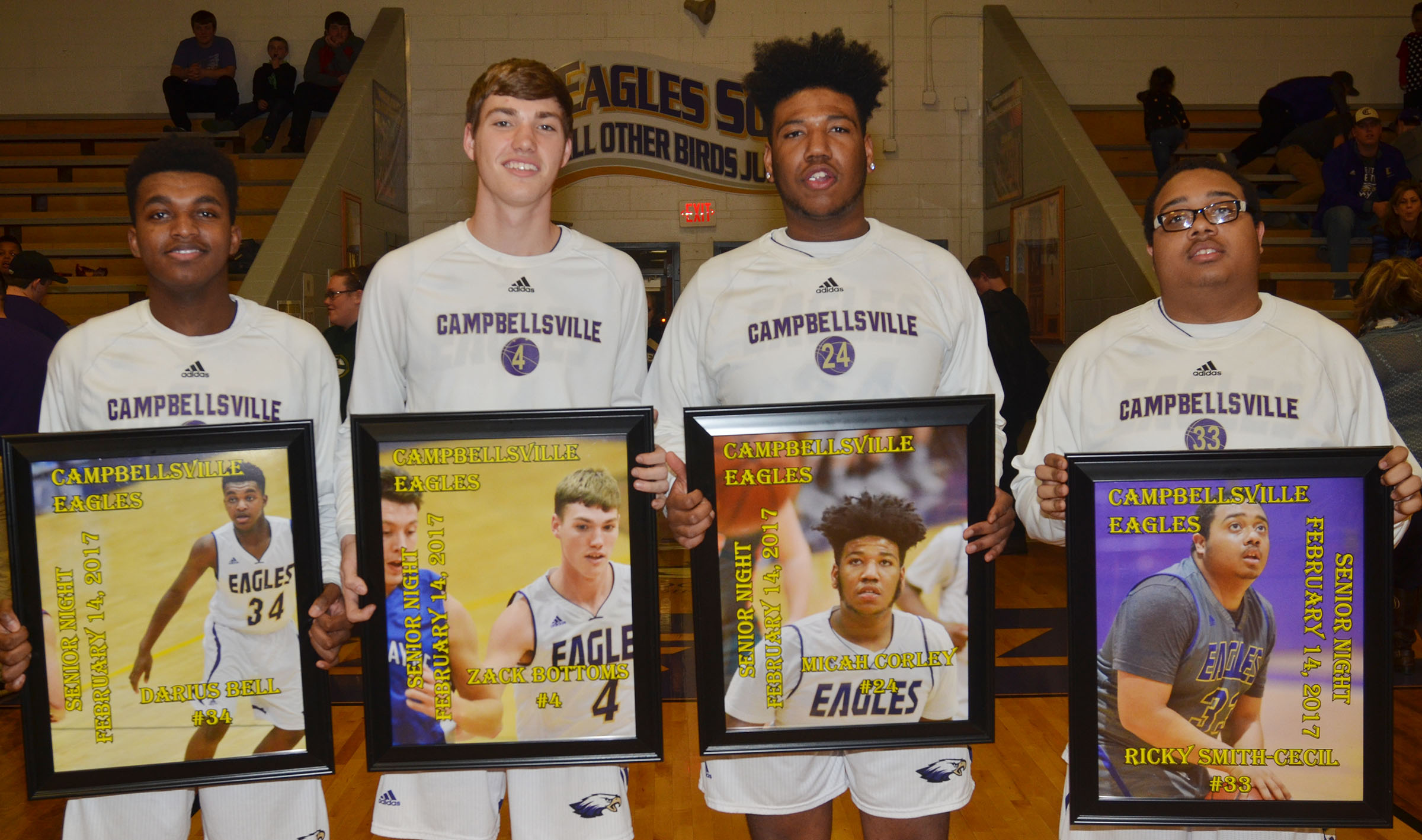 From left, CHS boys' basketball senior players Darius Bell, Zack Bottoms, Micah Corley and Ricky Smith-Cecil are honored for their dedication to their team.