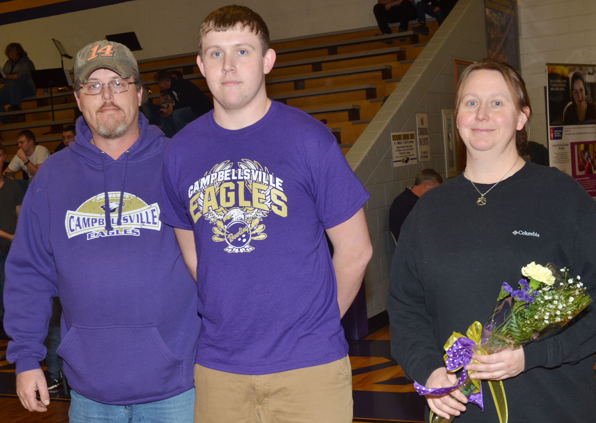 CHS senior bowling team member Jared Brewster is honored. He is pictured with his parents, Suzanne Davis and David Brewster.