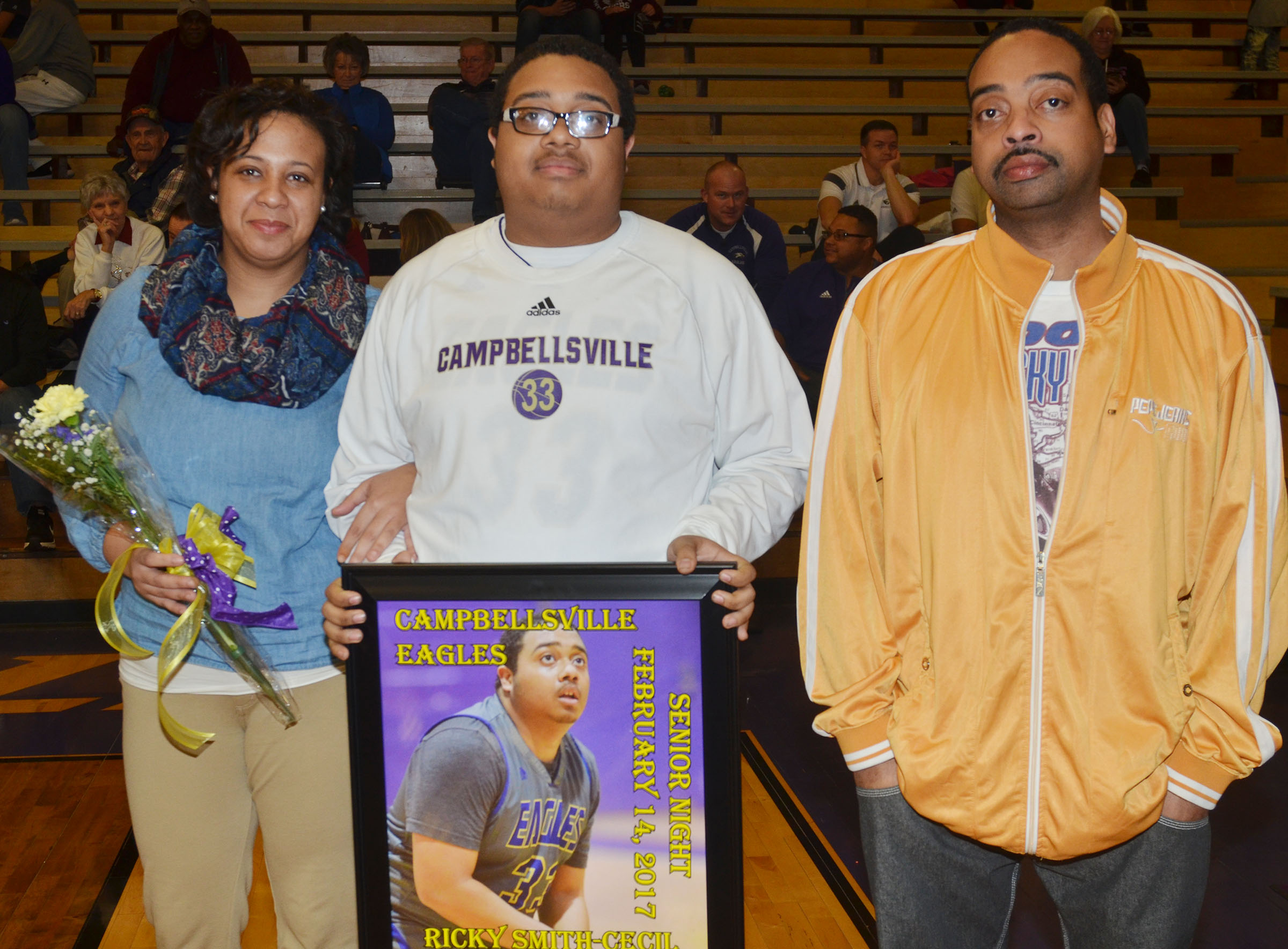 CHS senior boys' basketball player Ricky Smith-Cecil is honored. He is pictured with his parents, Cha-Cha Smith and Ricky Cecil.
